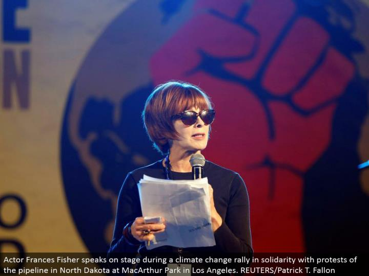 Actor Frances Fisher talks in front of an audience amid an environmental change rally in solidarity with challenges of the pipeline in North Dakota at MacArthur Park in Los Angeles. REUTERS/Patrick T. Fallon