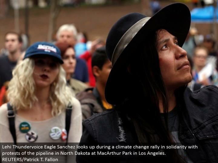 Lehi Thundervoice Eagle Sanchez gazes upward amid an environmental change rally in solidarity with challenges of the pipeline in North Dakota at MacArthur Park in Los Angeles.  REUTERS/Patrick T. Fallon