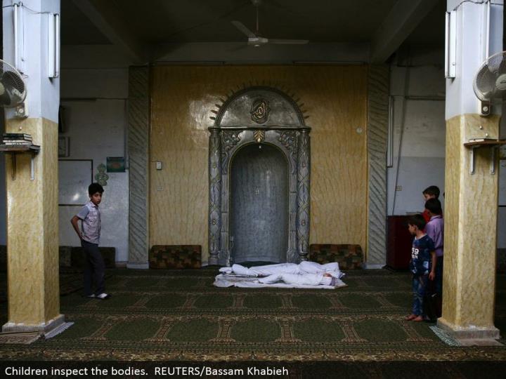 Children assess the bodies. REUTERS/Bassam Khabieh