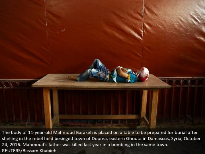 The collection of 11-year-old Mahmoud Barakeh is set on a table to be set up for internment in the wake of shelling in the revolt held attacked town of Douma, eastern Ghouta in Damascus, Syria, October 24, 2016. Mahmoud's dad was slaughtered a year ago in a besieging in a similar town. REUTERS/Bassam Khabieh