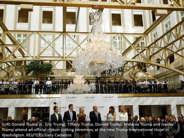 (L-R) Donald Trump Jr., Eric Trump, Tiffany Trump, Donald Trump, Melania Trump and Ivanka Trump go to an official strip cutting function at the new Trump International Hotel in Washington. REUTERS/Gary Cameron
