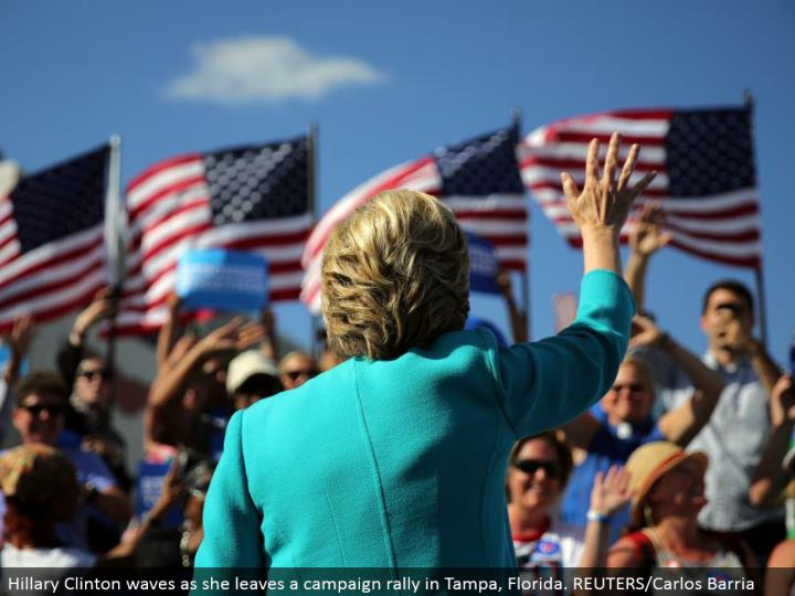 Hillary Clinton waves as she leaves a crusade rally in Tampa, Florida. REUTERS/Carlos Barria