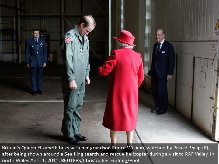 Britain's Queen Elizabeth converses with her grandson Prince William, viewed by Prince Philip (R), subsequent to being appeared around a Sea King hunt and safeguard helicopter amid a visit to RAF Valley, in north Wales April 1, 2011. REUTERS/Christopher Furlong/Pool