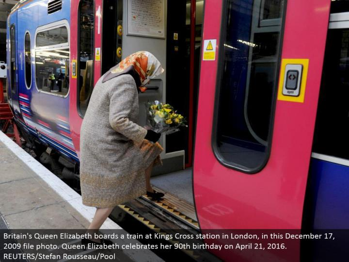 Britain's Queen Elizabeth sheets a prepare at Kings Cross station in London, in this December 17, 20...