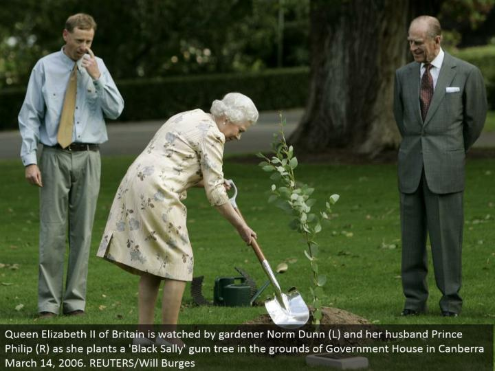 Queen Elizabeth II of Britain is viewed by nursery worker Norm Dunn (L) and her better half Prince Philip (R) as she plants a 'Dark Sally' gum tree in the grounds of Government House in Canberra March 14, 2006. REUTERS/Will Burges