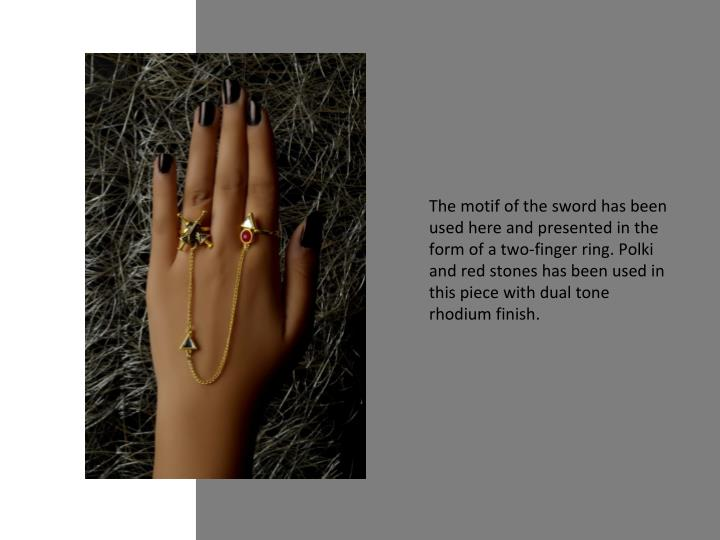 The motif of the sword has been used here and presented in the form of a two-finger ring. Polki and red stones has been used in this piece with dual tone rhodium finish.