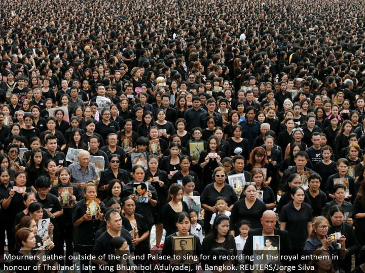 Mourners assemble outside of the Grand Palace to sing for a recording of the illustrious song of praise to pay tribute to Thailand's late King Bhumibol Adulyadej, in Bangkok. REUTERS/Jorge Silva