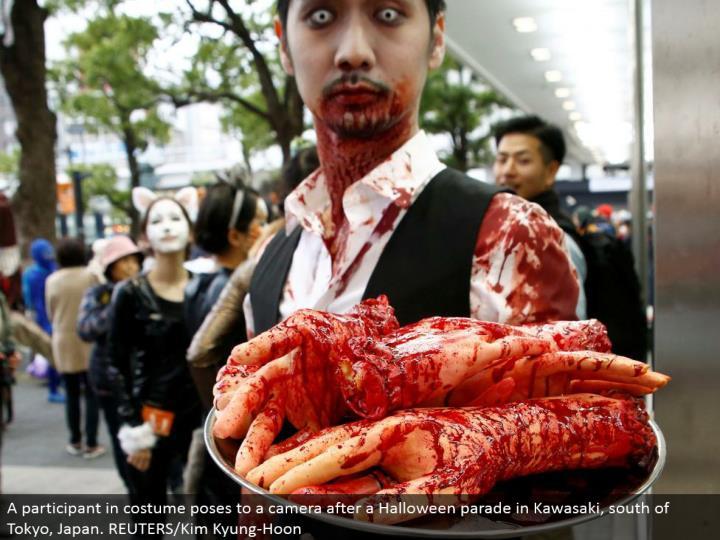 A member in ensemble stances to a camera after a Halloween parade in Kawasaki, south of Tokyo, Japan. REUTERS/Kim Kyung-Hoon