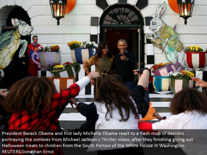 President Barack Obama and first woman Michelle Obama respond to a glimmer horde of artists depictin...
