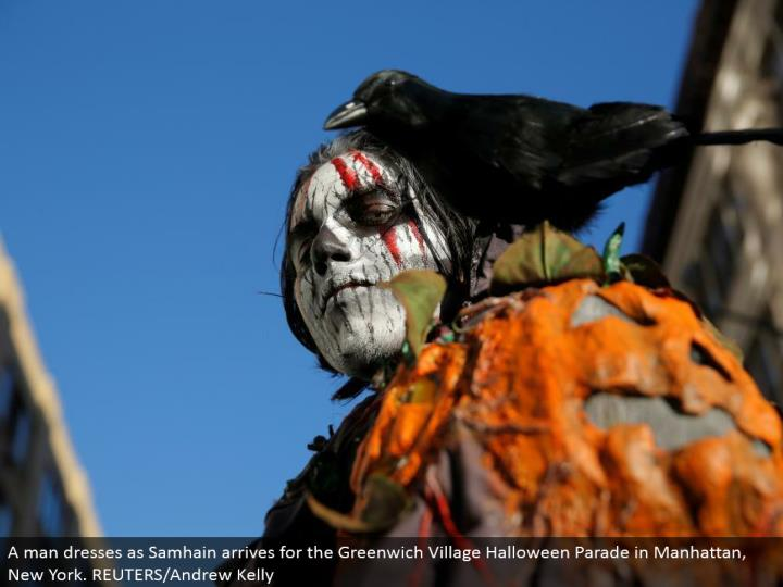 A man dresses as Samhain lands for the Greenwich Village Halloween Parade in Manhattan, New York. REUTERS/Andrew Kelly