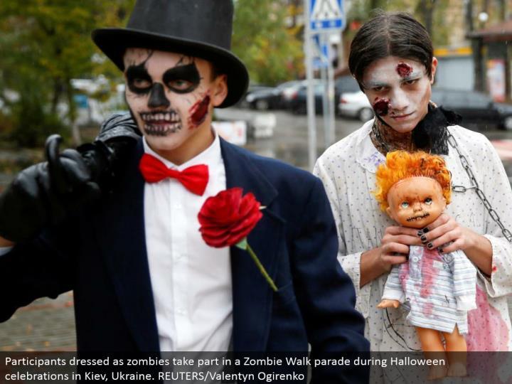 Participants dressed as zombies partake in a Zombie Walk parade amid Halloween festivities in Kiev, Ukraine. REUTERS/Valentyn Ogirenko