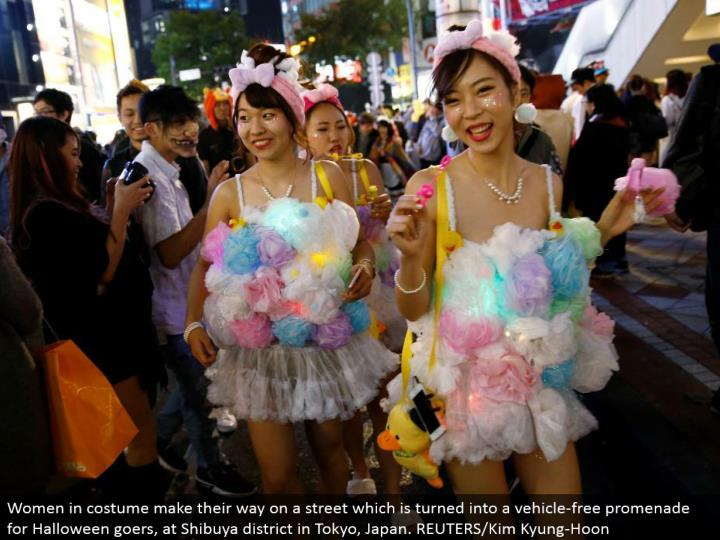 Women in outfit advance on a road which is transformed into a sans vehicle promenade for Halloween goers, at Shibuya area in Tokyo, Japan. REUTERS/Kim Kyung-Hoon
