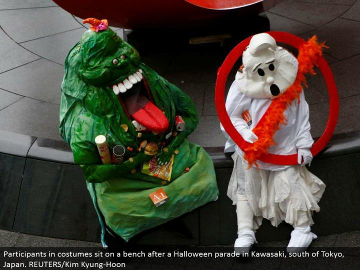 Participants in ensembles sit on a seat after a Halloween parade in Kawasaki, south of Tokyo, Japan. REUTERS/Kim Kyung-Hoon