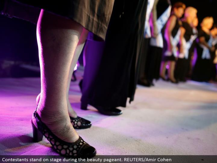 Contestants remain in front of an audience amid the excellence show. REUTERS/Amir Cohen