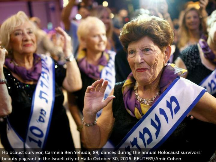 Holocaust survivor, Carmela Ben Yehuda, 89, moves amid the yearly Holocaust survivors' excellence exhibition in the Israeli city of Haifa October 30, 2016. REUTERS/Amir Cohen