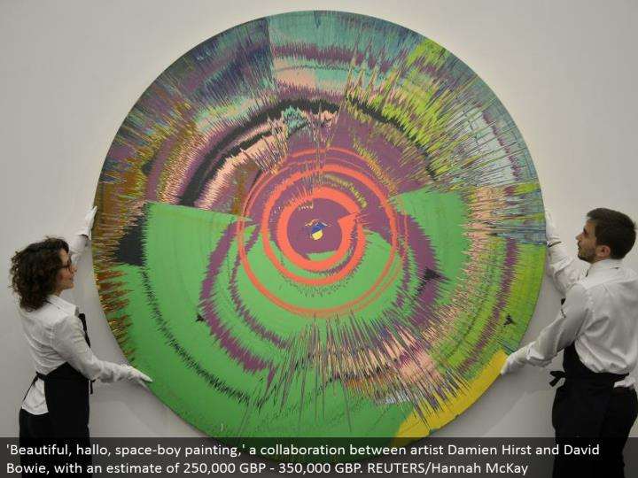 'Beautiful, hallo, space-kid painting,' a joint effort between craftsman Damien Hirst and David Bowie, with a gauge of 250,000 GBP - 350,000 GBP. REUTERS/Hannah McKay