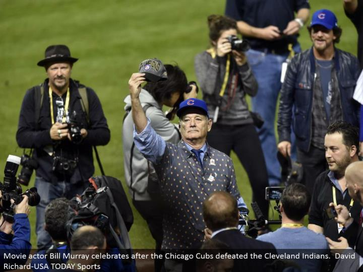 Movie on-screen character Bill Murray celebrates after the Chicago Cubs crushed the Cleveland Indians. David Richard-USA TODAY Sports