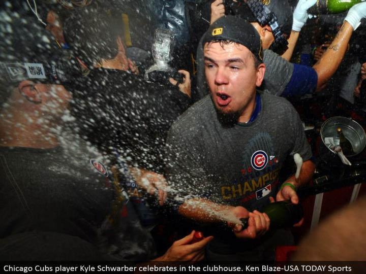 Chicago Cubs player Kyle Schwarber celebrates in the clubhouse. Ken Blaze-USA TODAY Sports