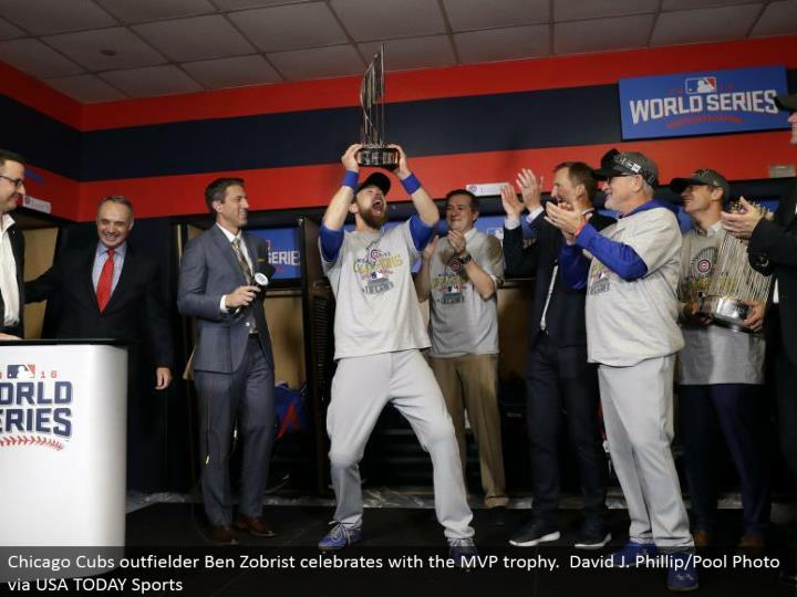 Chicago Cubs outfielder Ben Zobrist celebrates with the MVP trophy. David J. Phillip/Pool Photo by means of USA TODAY Sports