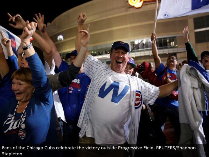 Fans of the Chicago Cubs commend the triumph outside Progressive Field. REUTERS/Shannon Stapleton