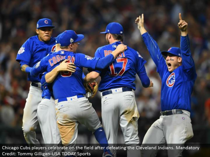 Chicago Cubs players celebrate on the field subsequent to crushing the Cleveland Indians. Obligatory Credit: Tommy Gilligan-USA TODAY Sports