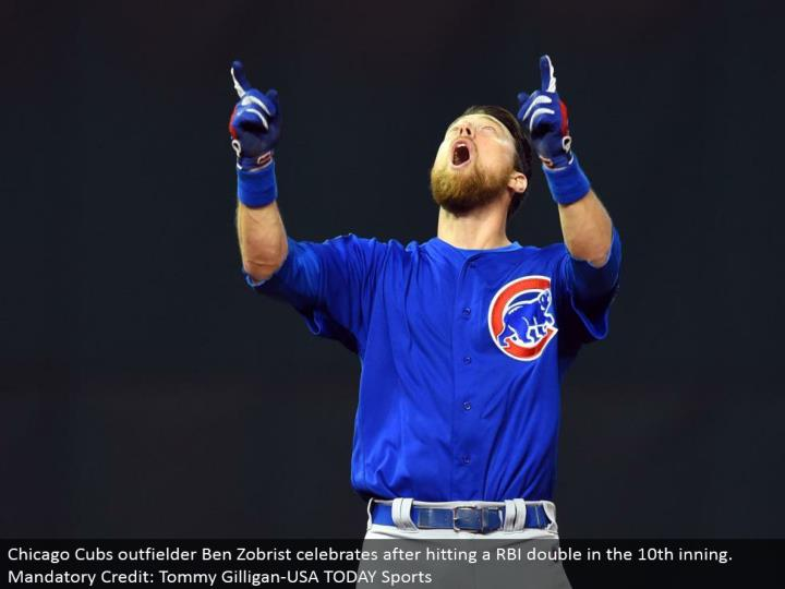 Chicago Cubs outfielder Ben Zobrist celebrates in the wake of hitting a RBI twofold in the tenth inning. Obligatory Credit: Tommy Gilligan-USA TODAY Sports