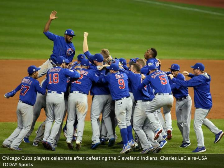 Chicago Cubs players celebrate subsequent to vanquishing the Cleveland Indians. Charles LeClaire-USA...