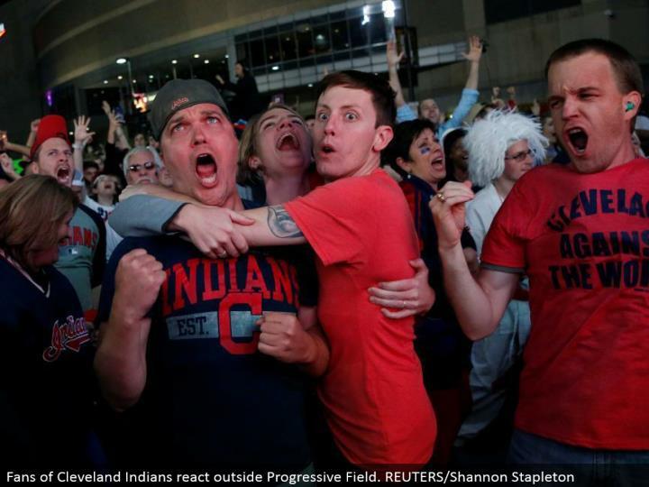 Fans of Cleveland Indians respond outside Progressive Field. REUTERS/Shannon Stapleton