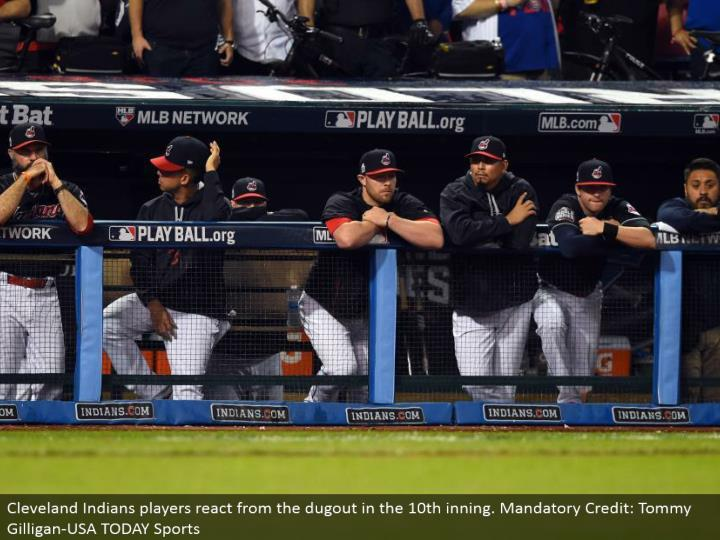 Cleveland Indians players respond from the burrow in the tenth inning. Obligatory Credit: Tommy Gilligan-USA TODAY Sports