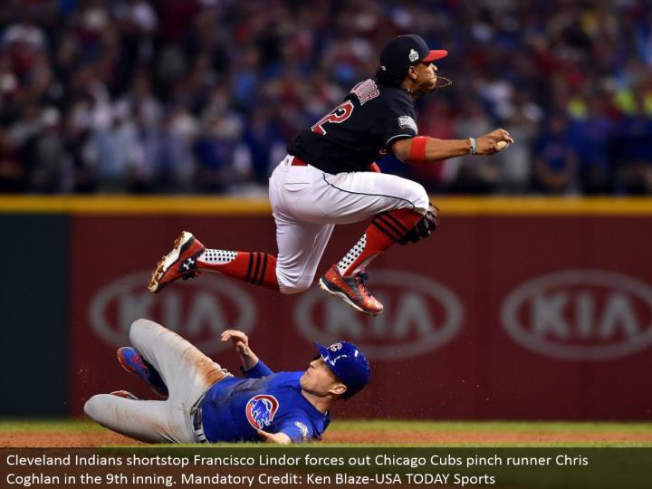 Cleveland Indians shortstop Francisco Lindor compels out Chicago Cubs squeeze runner Chris Coghlan in the ninth inning. Obligatory Credit: Ken Blaze-USA TODAY Sports