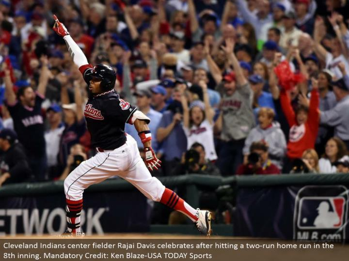 Cleveland Indians focus defender Rajai Davis celebrates subsequent to hitting a two-run grand slam in the eighth inning. Required Credit: Ken Blaze-USA TODAY Sports