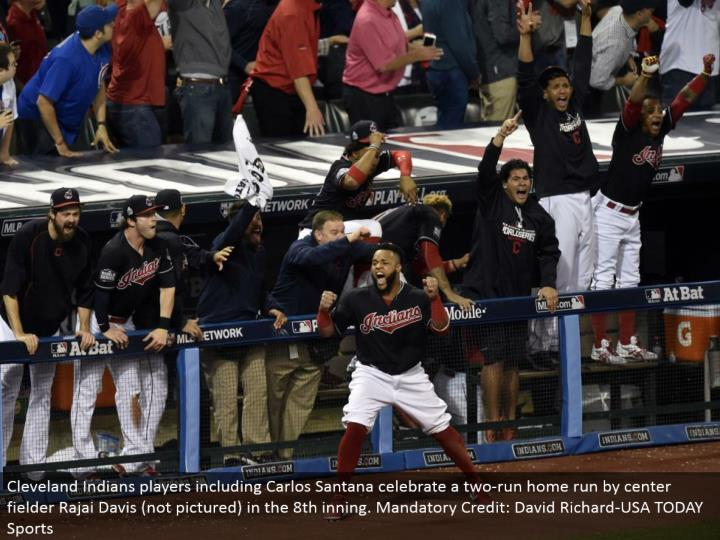 Cleveland Indians players including Carlos Santana praise a two-run grand slam by focus defender Rajai Davis (not envisioned) in the eighth inning. Required Credit: David Richard-USA TODAY Sports