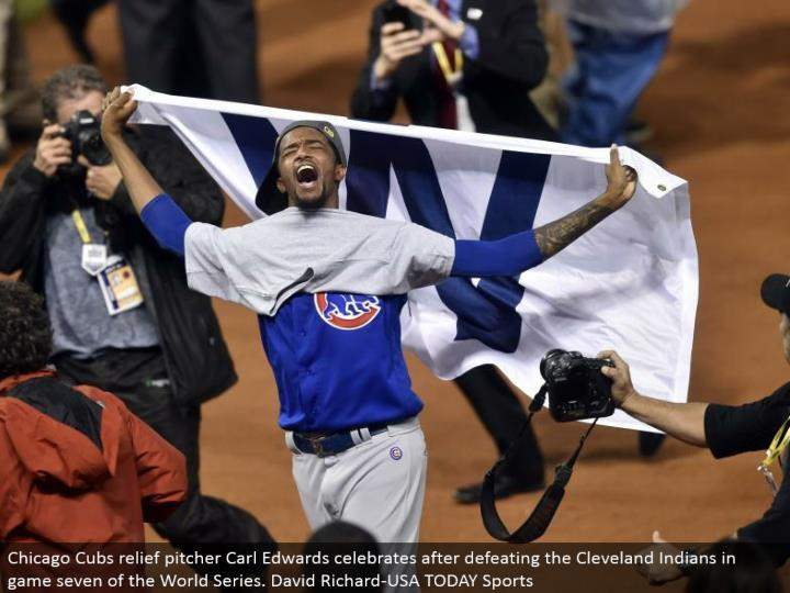 Chicago Cubs alleviation pitcher Carl Edwards celebrates in the wake of overcoming the Cleveland Ind...