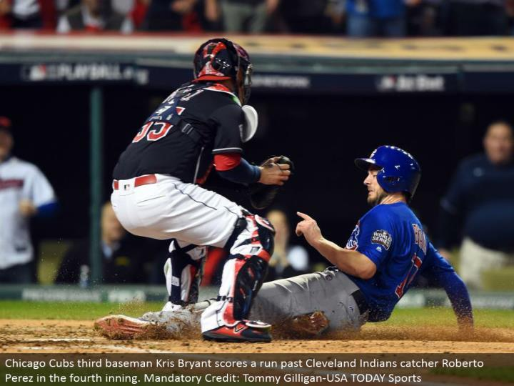 Chicago Cubs third baseman Kris Bryant scores a keep running past Cleveland Indians catcher Roberto Perez in the fourth inning. Required Credit: Tommy Gilligan-USA TODAY Sports
