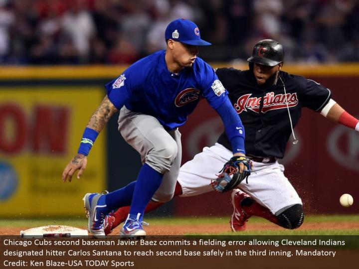 Chicago Cubs second baseman Javier Baez confers a handling blunder permitting Cleveland Indians assigned hitter Carlos Santana to achieve a respectable halfway point securely in the third inning. Obligatory Credit: Ken Blaze-USA TODAY Sports