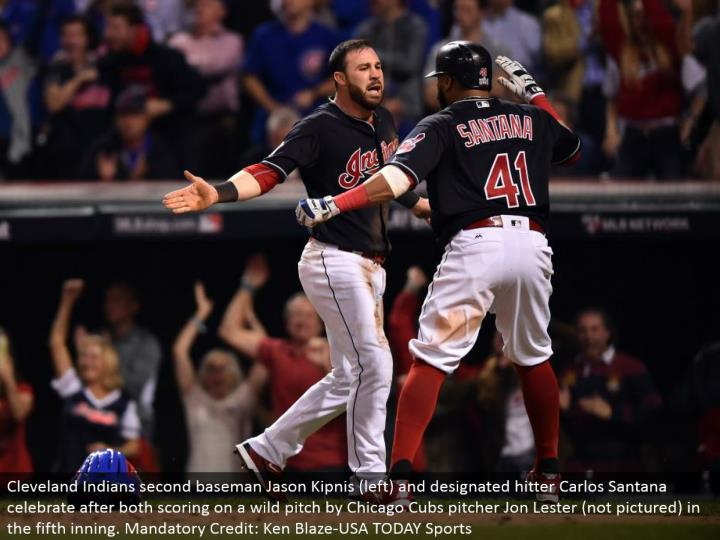 Cleveland Indians second baseman Jason Kipnis (left) and assigned hitter Carlos Santana celebrate after both scoring on a wild pitch by Chicago Cubs pitcher Jon Lester (not imagined) in the fifth inning. Required Credit: Ken Blaze-USA TODAY Sports