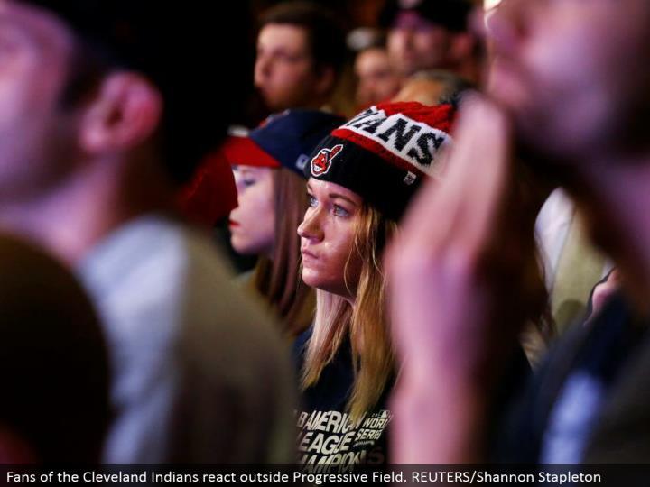 Fans of the Cleveland Indians respond outside Progressive Field. REUTERS/Shannon Stapleton