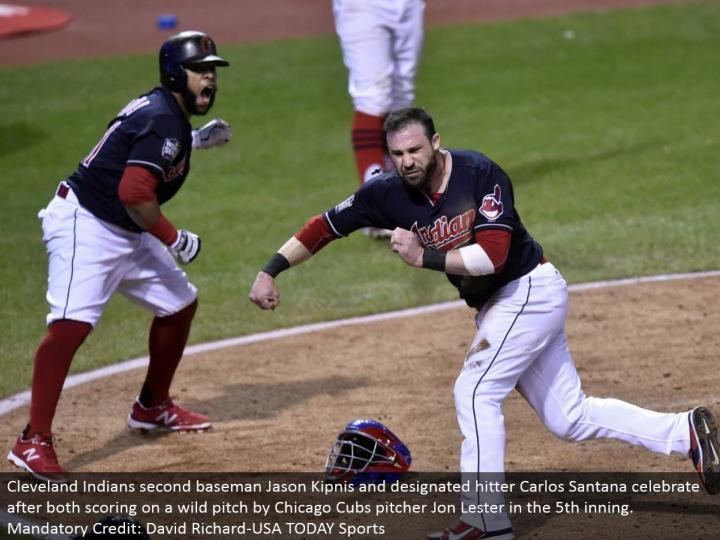 Cleveland Indians second baseman Jason Kipnis and assigned hitter Carlos Santana celebrate after both scoring on a wild pitch by Chicago Cubs pitcher Jon Lester in the fifth inning. Obligatory Credit: David Richard-USA TODAY Sports