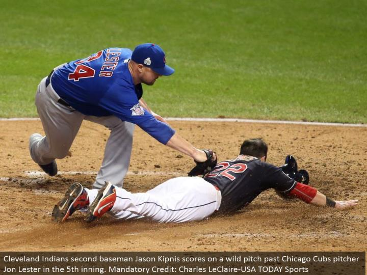 Cleveland Indians second baseman Jason Kipnis scores on a wild pitch past Chicago Cubs pitcher Jon Lester in the fifth inning. Compulsory Credit: Charles LeClaire-USA TODAY Sports