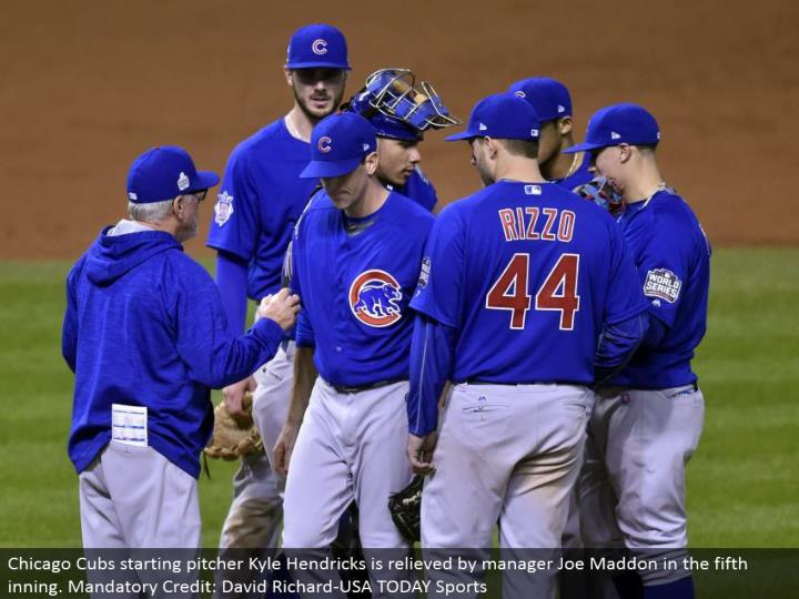 Chicago Cubs beginning pitcher Kyle Hendricks is soothed by administrator Joe Maddon in the fifth inning. Required Credit: David Richard-USA TODAY Sports