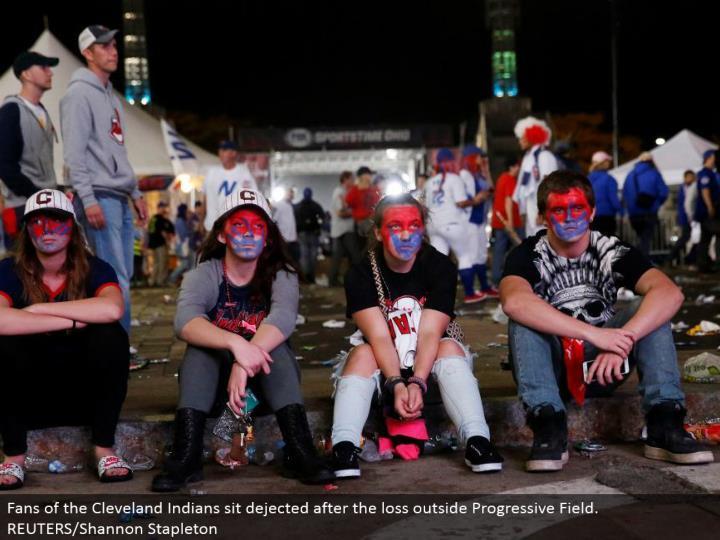 Fans of the Cleveland Indians sit crestfallen after the misfortune outside Progressive Field. REUTERS/Shannon Stapleton