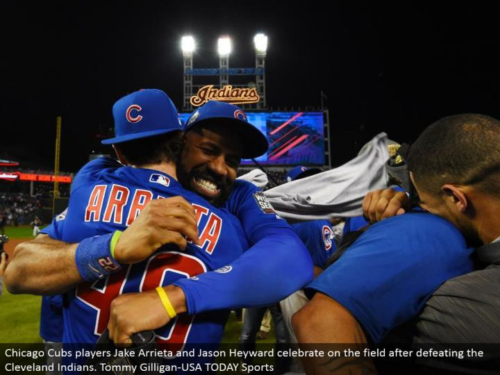 Chicago Cubs players Jake Arrieta and Jason Heyward celebrate on the field in the wake of vanquishing the Cleveland Indians. Tommy Gilligan-USA TODAY Sports
