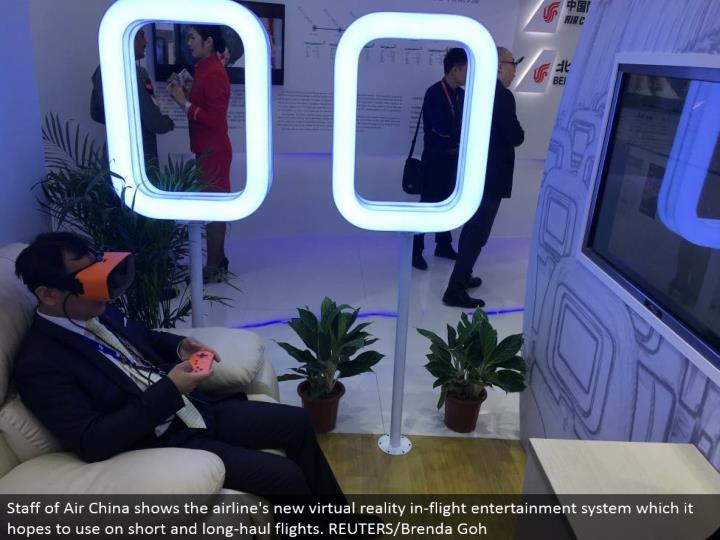 Staff of Air China demonstrates the aircraft's new virtual reality in-flight amusement framework which it plans to use on short and whole deal flights. REUTERS/Brenda Goh