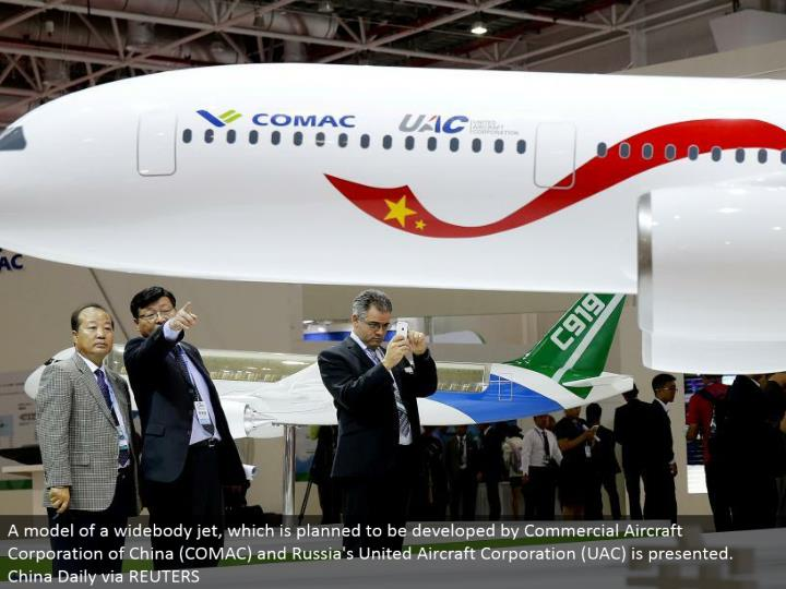 A model of a widebody fly, which is wanted to be created by Commercial Aircraft Corporation of China (COMAC) and Russia's United Aircraft Corporation (UAC) is displayed. China Daily by means of REUTERS