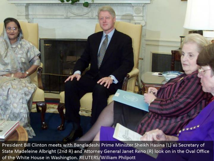 President Bill Clinton meets with Bangladeshi Prime Minister Sheik Hasina (L) as Secretary of State Madeleine Albright (second R) and Attorney General Janet Reno (R) look on in the Oval Office of the White House in Washington. REUTERS/William Philpott