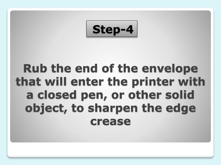 Rub the end of the envelope that will enter the printer with a closed pen, or other solid object, to sharpen the edge crease