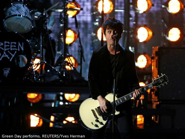 Green Day performs. REUTERS/Yves Herman