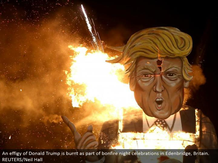 An representation of Donald Trump is singed as a component of campfire night festivities in Edenbridge, Britain. REUTERS/Neil Hall