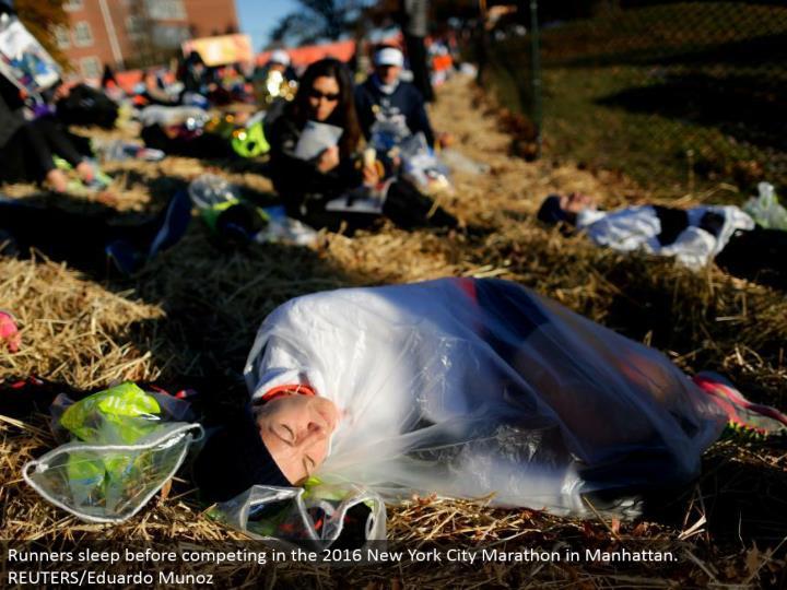 Runners rest before contending in the 2016 New York City Marathon in Manhattan. REUTERS/Eduardo Muno...