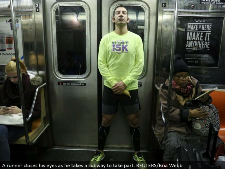 A runner shuts his eyes as he takes a metro to partake. REUTERS/Bria Webb